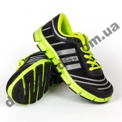 Детские кроссовки Adidas черно-зеленые шнурок